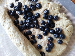press blueberries into dough. yay for antioxidants and flavanoids!